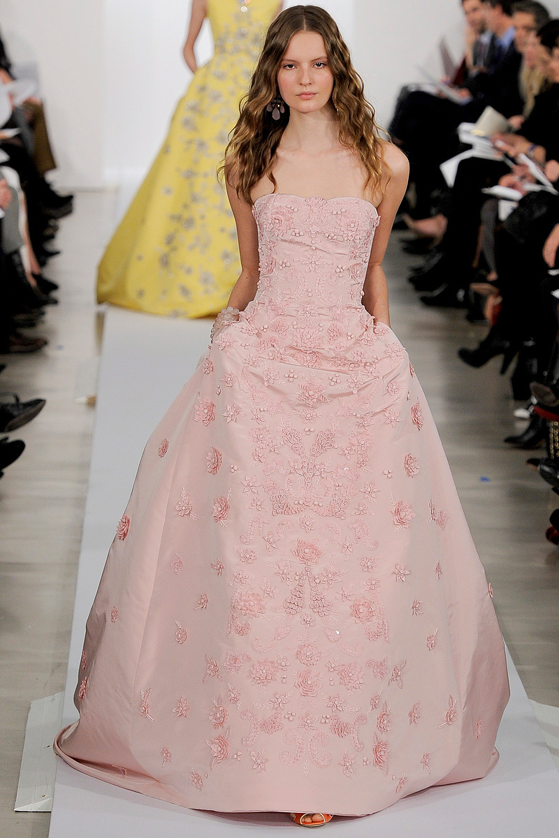 Sienna is in an Oscar de la Renta Fall 2015 gown.